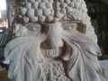 Green man with berries. Hand carved Tetbury limestone.