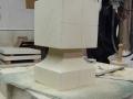 Work round the neck creating mitres