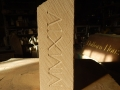 Celtic knotwork commission with Roman Numerals. Portland limestone.