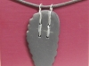 Welsh slate pendant with button stitching design. Sterling Silver wire.