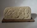 Tetbury limestone flower on oak base. £55