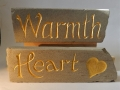 Warmth hand carved and gilded, £105. Heart, hand carved and painted, £ 62