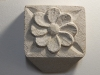 "Pretty flower, carved in Tetbury limestone 3""square. £25"