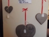 Chinese slate hearts on red ribbon. Different sizes and initials engraved to order.