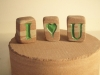 Small Forest of Dean Sandstone  initials and hearts £7 each. Less that an inch