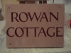 House name, Forest of Dean Sandstone, painted burgandy.