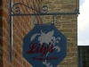 Refurbished and painted metal sign.