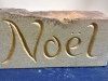 "Forest of dean Sandstone, carved and painted gold, suitable for outside. 5""long. £22"