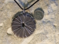 Spinning wheel Welsh slate pendant with sterling silver stitching-same both sides (showing my masons mark on the reverse.)