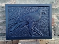 relief carving of a Hawk in Welsh slate