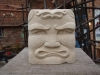 Tiki man, Portland limestone. 4 &amp; 3/4 inch square. 95