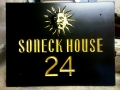 Hand Carved house sign, Welsh Slate, with Sun motif. Gilded and oiled.