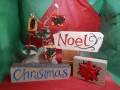 hand carved and painted Christmas is £95, £6 for the hanging decorations . The Poinsettia carving is £75 and the Noel with a scroll is £58