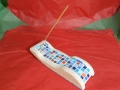 Incense stick holder,  hand carved Tetbury limestone with mosaic inlay, £55