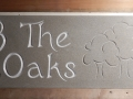 3 The Oaks, Hand carved and painted Forest of Dean sandstone