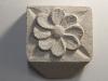 "Pretty flower, carved in Tetbury limestone 3""square. £25"