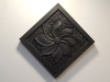 Swirling flower carved in Welsh slate and oiled. 5.5 inches square. £65