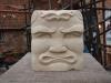 Tiki Man, Portland limestone, 4 & 3/4 inch square