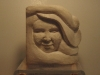 """Small face carved from Portland limestone 3"""" square, £60. Sold"""