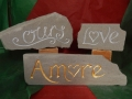 Amore ,hand carved and gilded £85, Love, hand carved and painted £45, Ours, hand carved and painted £58