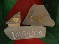 Hope, hand carved and painted £58, Hearts,  hand carved and painted £20, Imagine, hand carved and painted £68