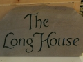 House name hand carved in Forest of dean sandstone. Commission painted green.