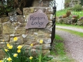 House sign carved in Forest of Dean sandstone from Blakeney, painted black.