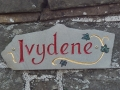 House sign, hand carved, painted and gildedin Forest of Dean sandstone from Birch Hill.