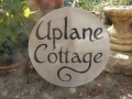 Uplane Cottage on a round piece of Forest of Dean Sandstone.