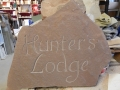 Hand carved unpainted house sign