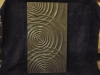 Intersecting ripples carved in Welsh slate