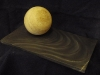Tetbury limestone ball on Cornish Slate carved with bow wave.