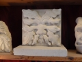 Hand carved creatures in Tetbury limestone, Portland limestone and Tetbury limestone