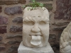 Cheeky Gargoyle with Ivy plant in his head.